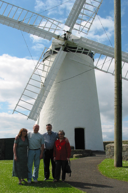 Cousin Henry and Geraldine and Bee and I  in front of the Ballycopeland windmill in 2002.