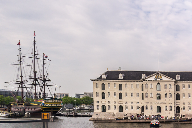The National Maritime Museum. The ship on the left is a replica of the Amsterdam, a merchant ship during the Dutch Golden Age.
