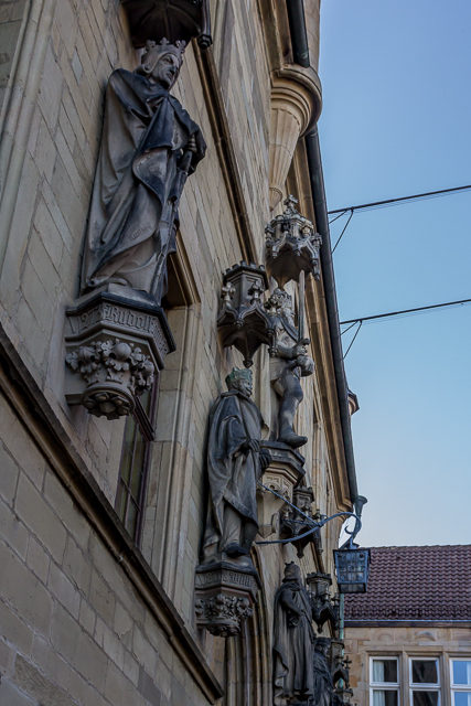 Statues adorn the front of Osnabrück's City Hall (Rathaus).