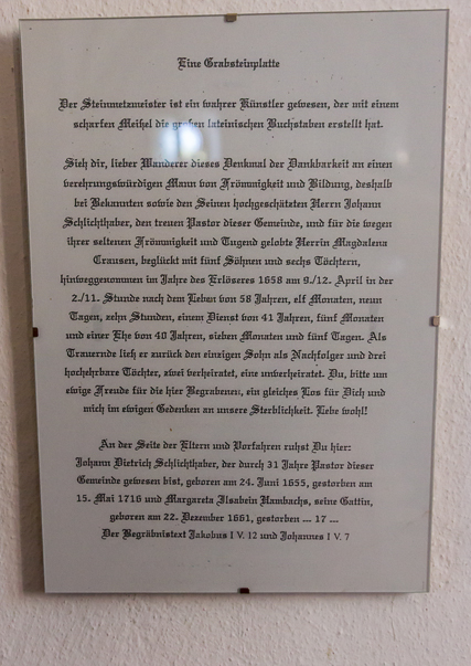 Inscription translated to German.