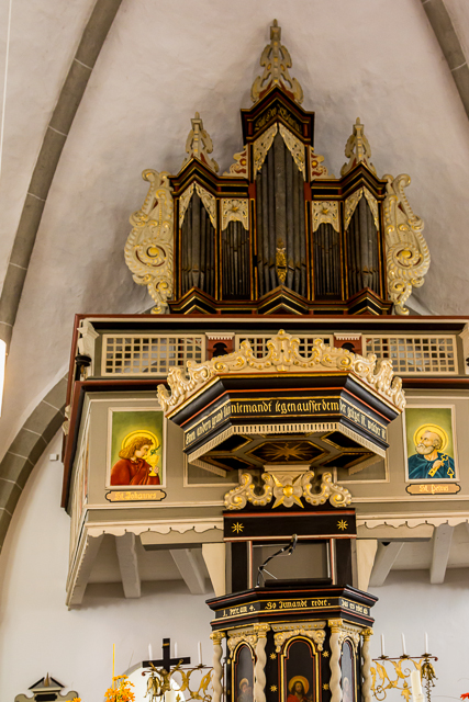 The pulpit and organ are behind the main altar.