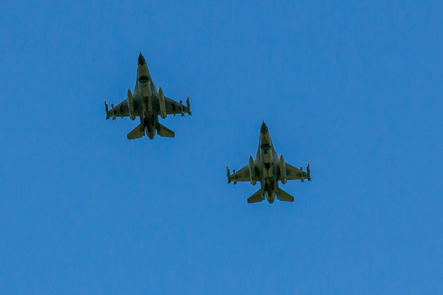 Two Belgian Air Force planes passed overhead at the conclusion of Taps.