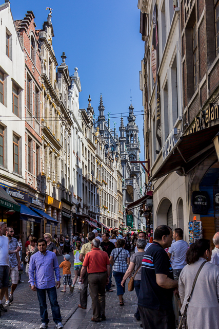 The last block of Rue au Beurre before reaching the Grand Place. The building in the distance with all of the steeples and statues is La Maison de Roi (The King's House). It is also the Brussels City Museum (Musee de la ville Bruxelles).