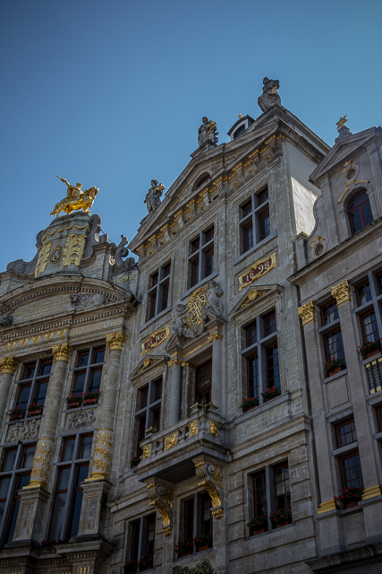 Grand Place Guild Halls proudly display their completion dates.