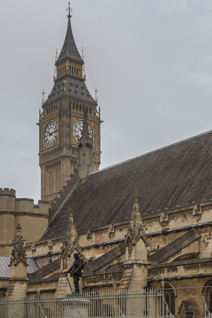 The Tower of Big Ben (officially Elizabeth Tower) looms over Westminster Hall and Oliver Cromwell.