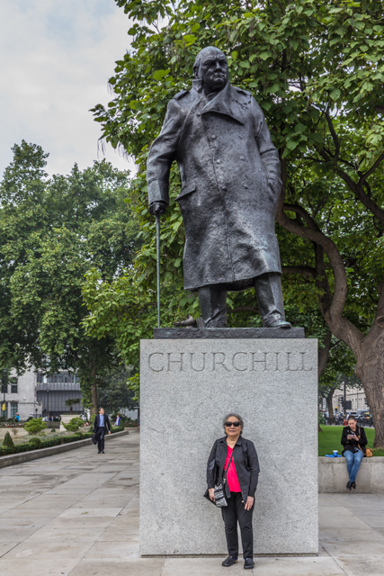 Churchill monument in Parliament Square gardens. The statue is wired with a heating element so that pigeons won't land on his head.