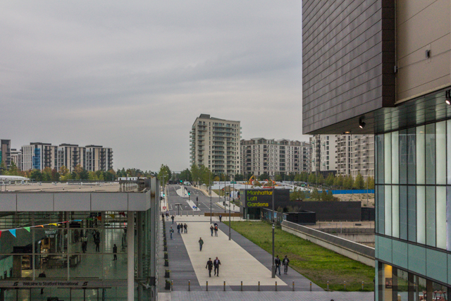 View from steps leading to the Premier Inn on the north side of Westfield, about five minutes from our hotel. Stratford International opend in 2008 and has platforms for high-speed trains to Kent and to St Pancras and the EuroStar. It also services the DLR.  The Manhattan Loft skyscrapers will be completed in 2016 and will feature community lofts in lieu of private balconies. The buildings in the background were used to house the athletes who competed in last year's Olympic Games.