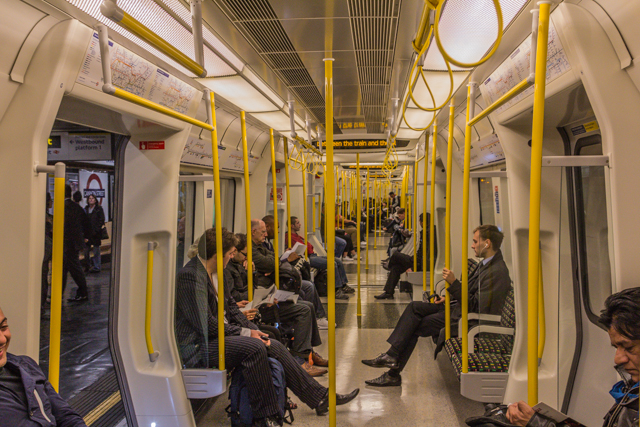 Inside a cheerful District line car.