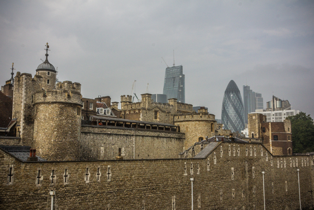 The Tower of London with modern skyscrapers in the background.