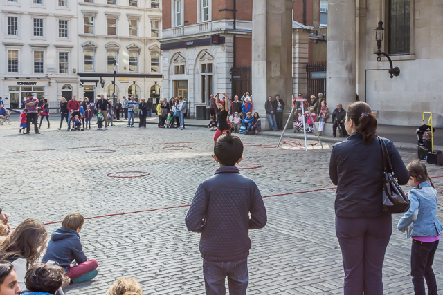 A busker performs in front of St Paul's Church.