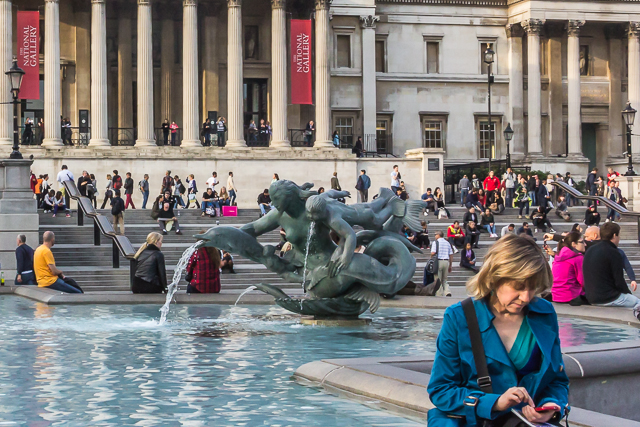 The west (Jellicoe) fountain, dolphin-mermaid-triton sculpture, steps and terrace in front of the National Gallery. The pedestrian terrace came into being in 2003.  Before that there was a one-way motorway that surrounded the square.
