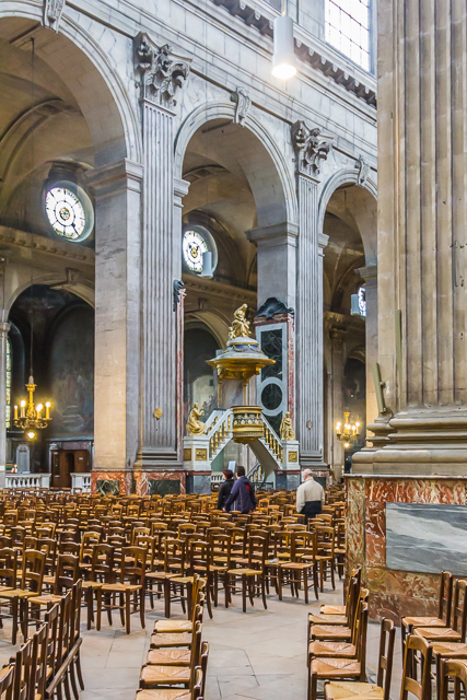 A view of the nave with the pulpit designed by Charles de Wally.