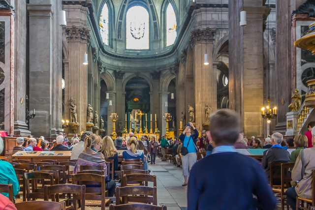 Listening to the mini-concert after Mass.