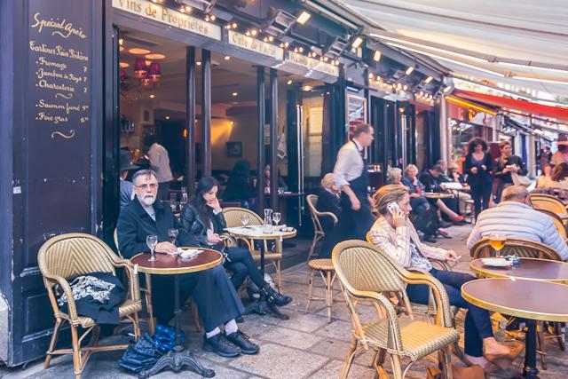 Enjoying a glass of wine at the Cafe de Paris on the Rue de Buci. I think it was a Bordeaux.