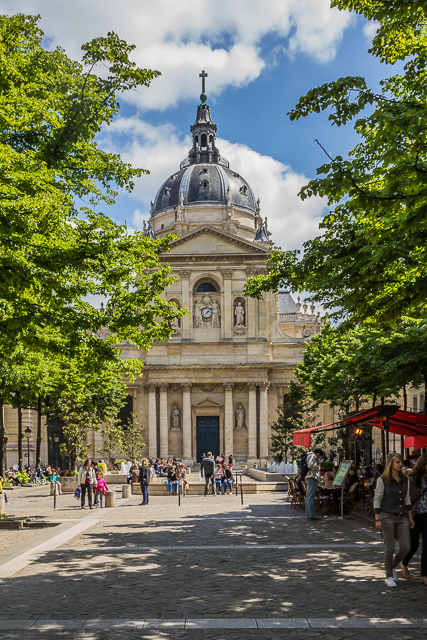 The chapel and Place de la Sorbonne from Blvd St Michel. We had lunch at the cafe on the right. I had a delicious quiche Lorraine and a tasty chablis. My wife had a Caesar salad.