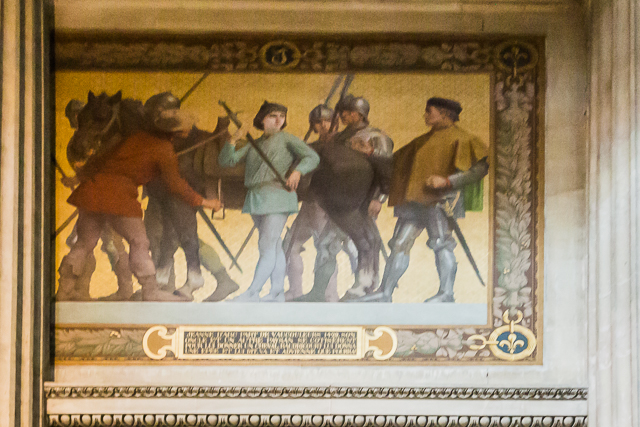 The first frieze on the wall: Joan goes off to war.