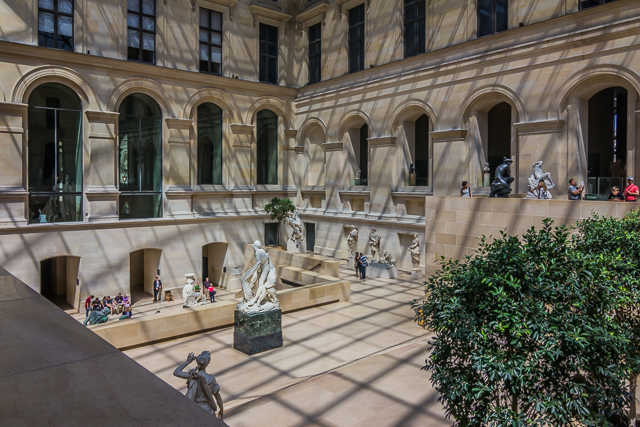 The original photo showing French sculpture on multiple tiers of the Puget Courtyard in the Louvre's Richelieu wing.