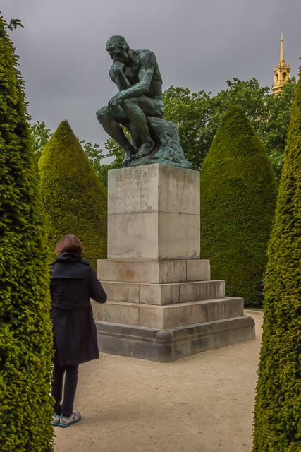 Rodin is buried under his statue of The Thinker (le penseur).