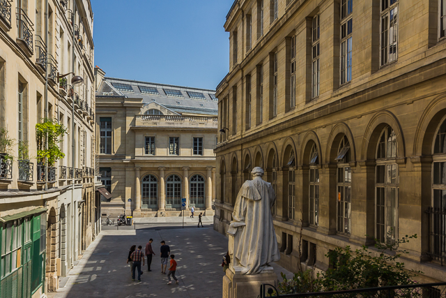 View of Rue de Antoine Dubois from Rue Monsieur le Prince. In the background is the main building of Paris Descartes University (University of Paris V) on Rue l'Ecole de Medicine. Dubois was a surgeon who practiced at the University. The statue is of Alfred Vulpian,  a neurologist and university administrator and friend and associate of Charcot.