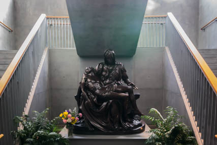 Bronze replica of Michelangelo's Pieta at the foot of the staircase and entrance to the mausoleum.