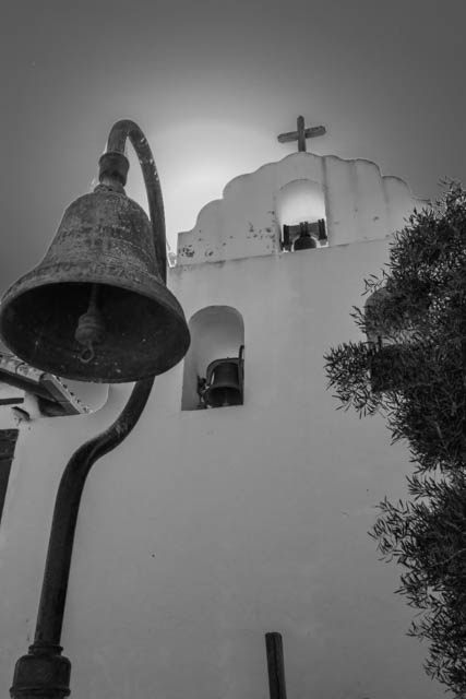 Here's the front of the Mission Bell Tower.  The bell in the foreground is one of the markers on the El Camino Real that stretches for more than 600 miles from San Diego to Sonoma and connects all 21 Missions.