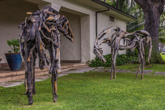 The two horses outside the museum's main entrance were sculpted by Deborah Butterfeld. She created the statues from wod and then disassembled them and cast each wooden piece in bronze.