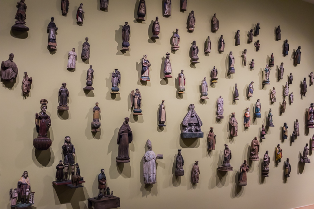 Small religious statues adorned an entire wall in the Philippines gallery.
