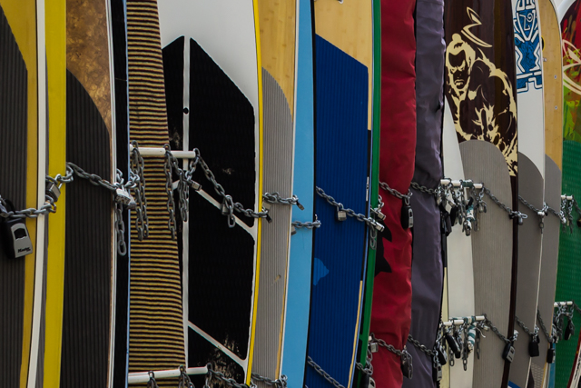 Surf boards on a rack near the Outrigger Reef Hotel. Thanks to Duke, you can see surf boards like these throughout the world.