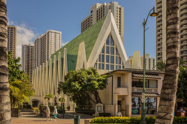 View of St Augustine Catholic Church from Kalakaua Ave at Kuhio State Beach.