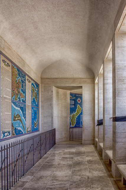 Portions of the World War II Pacific Theater galleries at the Honolulu Memorial. The map of Guam is in the center background. On the left are maos f Attu (Aleutian Islands), Tarawa (Gilbert Islands), and Kwajalein Atol (Marshall Islands).