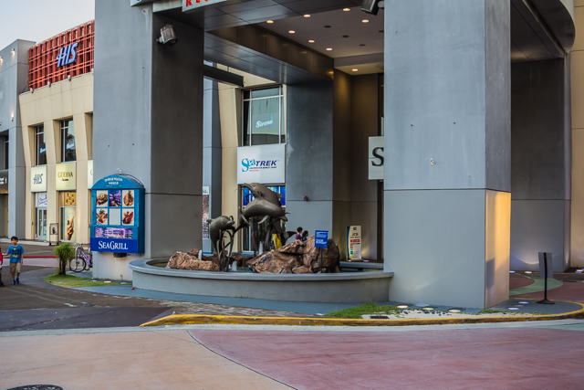 Dolphin sculpture in front of Sea Grill restaurant at entrance to Outrigger parking garage.