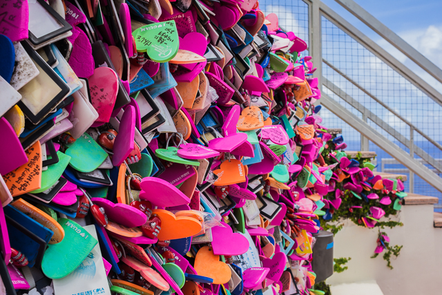Close-up of some of the love-locks. Some are plastic, some metal, most are heart-shaped and made of foam.