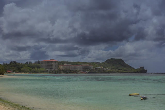 The Hilton Guam Resort and Spa at the south end of Tumon Bay. The building at the extreme right is one of two Hilton wedding chapels. This photo was taken from the beach in front of the Fiesta Resort.