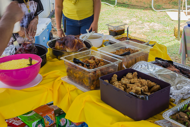 Some of the food on tables at the other end of the tent: potato salad, turkey, different kinds of chicken. At the back corner of the table is the Chamorro's favorite sauce, fina'denne, which is mostly vinegar, onions and lots of peppers.