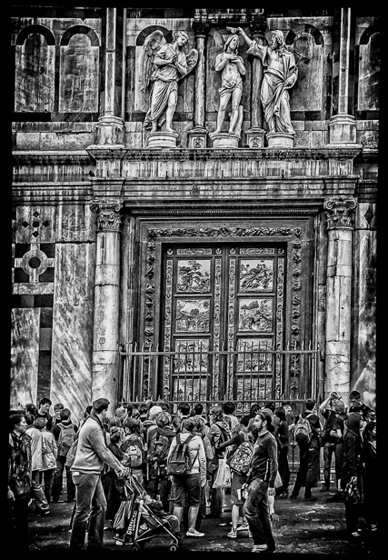The famous bronze doors of the Baptistry adjacent to the Duomo.