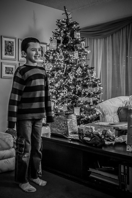Our grandson and our Christmas tree in our living room on Christmas Day, 2010.