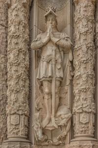Sculpture on left side of crypt portal.
