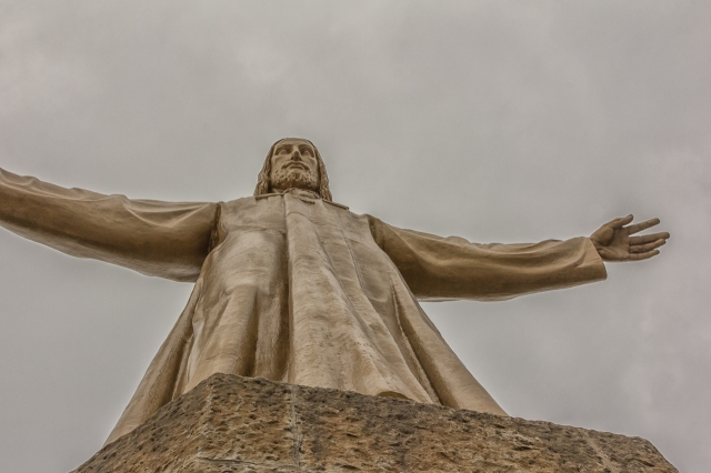 View of Christ statue from platform at top of staircase.