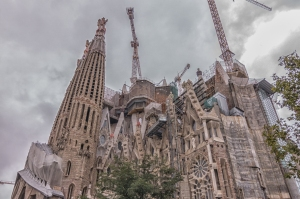 The finished basilica will have 18 towers but right now there are only eight: four on the nativity facade and four on the passion facade (left). The glory facade (right) eventually will also have four towers. The there will be six taller towers in the middle.