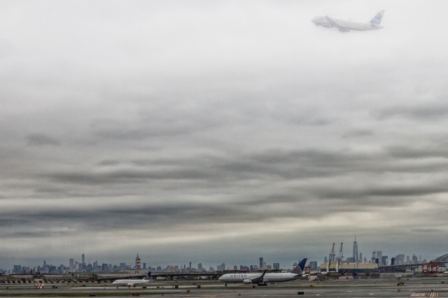 The New York City Manhattan skyline from Newark Liberty International Airport. I was fortunate to catch a plane taking off right over One World Trade Center.