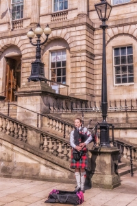 And sometimes the piper is a woman! Both of these photos were taken in front of the General Register Office at the beginning of Princes Street in Edinburgh.