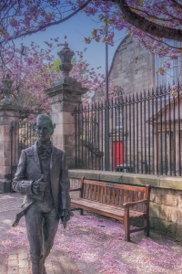 The bronze statue of the poet Robert Fergusson on the grounds of Canongate Kirk.